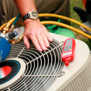 Technician troubleshooting a heating and air conditioning issue